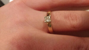 .53 carot Princess cut natural diamond set in 14kt gold.