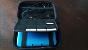 Blue 3DS XL with case and games