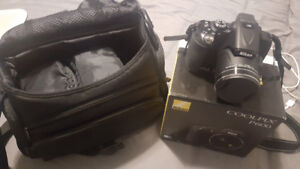 Nikon coolpix p600 digital camera with case and tripod