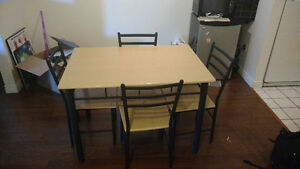 Table and 4 chairs! Decent shape, trade for case of beer