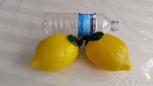 PAIR OF GLASS LEMONS FROM ITALY. $10 FIRM. NO CHIPS OR BLEMISHES