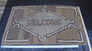 "Antique hooked rug with 'Welcome"" Motif."