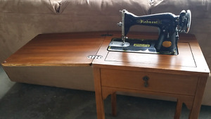 Vintage sewing machine cabinet with sewing machine