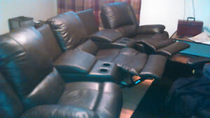 3 Seat Recliner, with 4 cup holders and 2 storage arm rests.