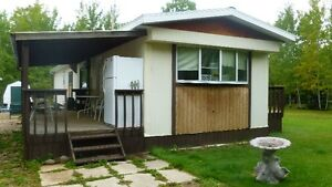 Mobile Home in Turtle Lake MLS#598338