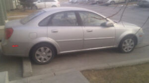 I am selling a chevy optra with head gasket problems $1000