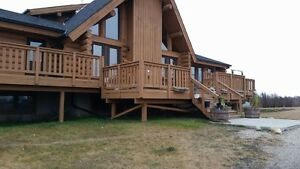 COME LIVE IN THE COUNTRY NW OF AIRDRIE IN 7000 sq ft Log home
