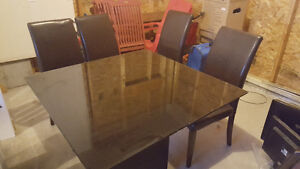 Glass top square Dining Table with 4 brown person casana chairs