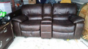 Leather powered reclining couch/loveseat with center console