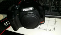Canon Rebel T1i / 3 lenses and extra battery.