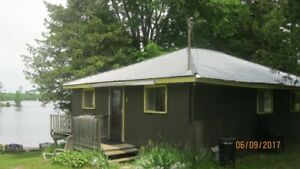 4 bdr waterfront cottage $750 plus HST a week