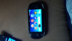 OLed Ps Vita, games, memory card, and cases
