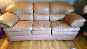 Leather couch, love seat and ottoman
