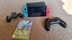 Nintendo switch console for sale. With zelda botw and extra controller