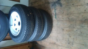 4 NEW ST 205/75 R15 TRAILER TIRES AND RIMS