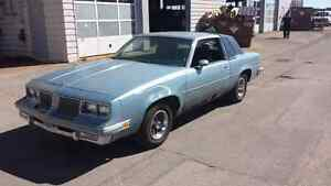NEED GONE 86 cutlass supreme for sale