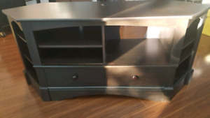 Tv Stand > Dark Mocha in color. Solid unit W/ Shelves  & drawers
