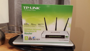 Canon Printer and a TP-Link Wireless Router.