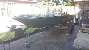 14' Light Fibreglass boat with trailer. Loaded with accesories