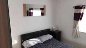 Double room in Beeston - flat screen TV & storage