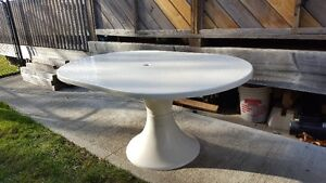 White patio table with large Green Umbrella/ stand