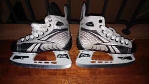 Patin de hockey extensible (Reebok)