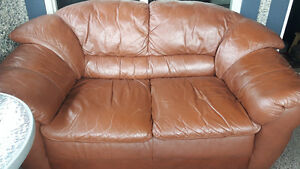 Brown leather couch and loveseat