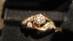14K.585 SOLID GOLD AND APROX .90TCW DIAMOND ENGAGEMENT RING