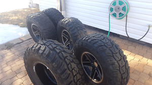 """(Full set of 5) 32"""" mud tires with rims"""