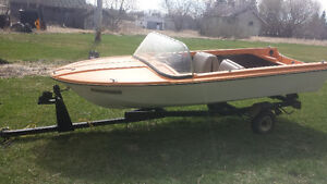 14 ft boat ( needs repair) with trailer