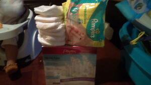Newborn package opened not used plus more diapers an bottles Kitchener / Waterloo Kitchener Area image 1
