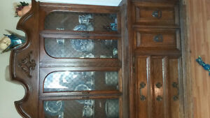 old fashion two piece style glass hutch