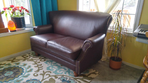Set of 2 matching leather love seats