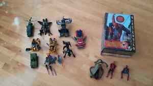 Transformer toys, spiderman figures. and spiderman case