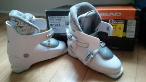 Kids 2 x SkiBoots and 2 x Poles