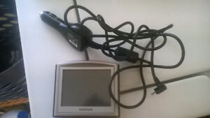 tom tom gps with adapter exc working order