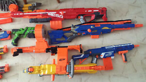 14 Nerf guns and accessories
