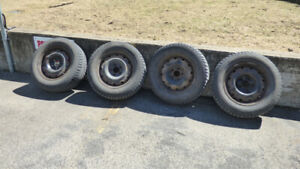 4 X 215 / 65 R16 used winter tires on rims for sale