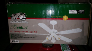 CEILING FAN WITH LIGHTS.  BRAND NEW. IN THE BOX.