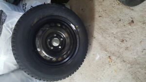 Four brand new 195/65/15  winter tires and rims.