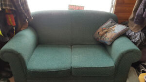 Green couch and loveseat