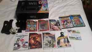 Nintendo wii in box with games