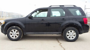 2010 Mazda Tribute LX 5spd Safety Read Ad