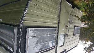 Camper with wood stove