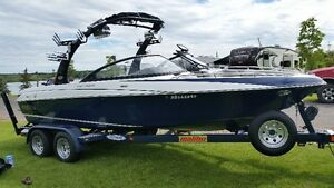 Malibu Surf Boat with rebuilt motor and trailer