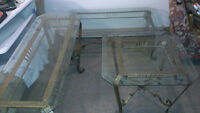 Set of three glass and metal coffee tables.