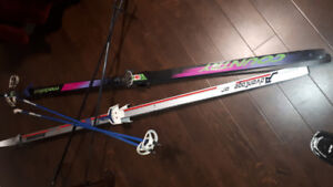 pair each of mens and ladies X country skis, includes poles