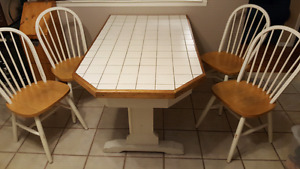 Solid Kitchen Table and Four Chairs.