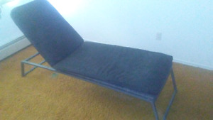 Gray wicker lounge chair