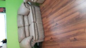 Faux leather taupe couch and love seat